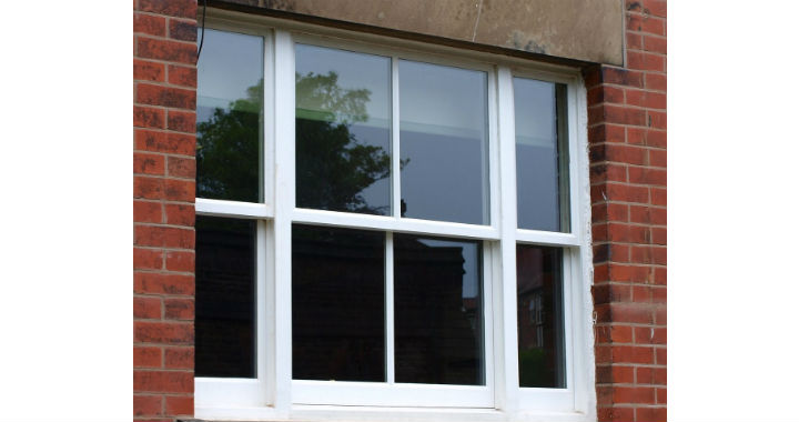 Wooden windows protected by paint